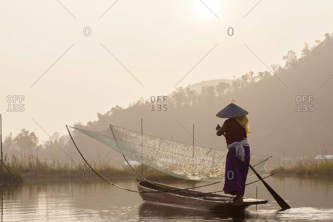 Fisherman paddling a boat on Loktak Lake in Imphal, Manipur, India