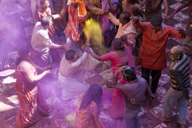 - February 28, 2010: People dancing during Holi festival, Mathura, Uttar Pradesh, India