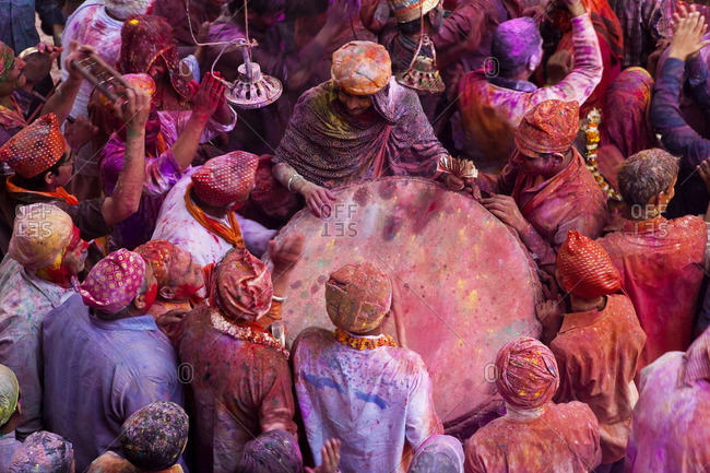 - March 1, 2010: People around a drum in a temple during Holi festival, Mathura, Uttar Pradesh, India