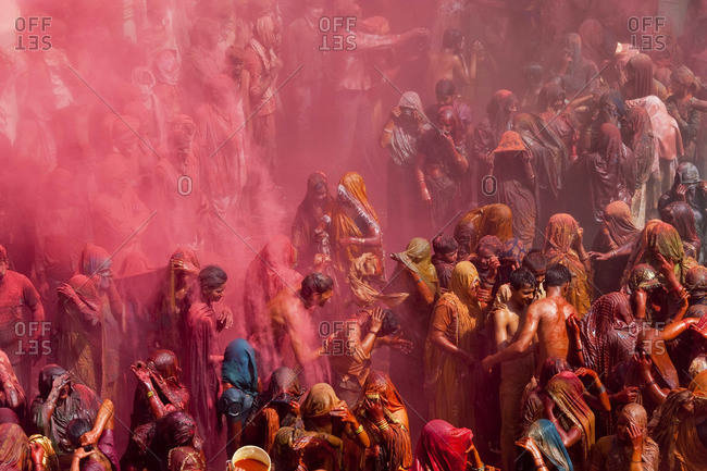 - March 2, 2010: People celebrating Holi festival at a temple near Mathura, Uttar Pradesh, India