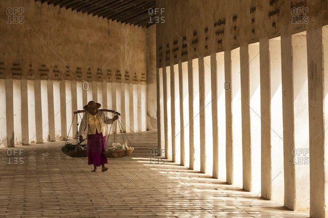 Person walking in walkway to Shwezigon Pagoda, Bagan, Myanmar (Burma)