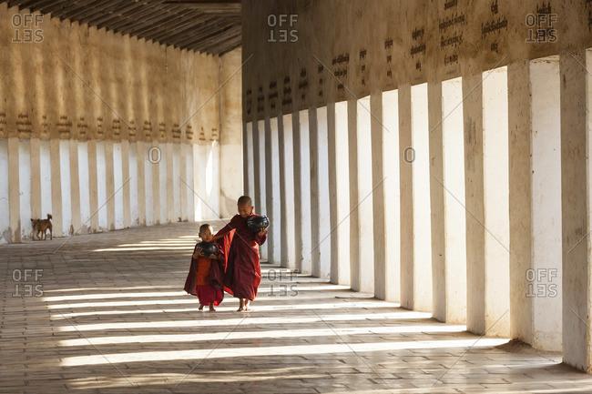 - January 30, 2013: Young monks in walkway to Shwezigon Pagoda, Bagan (Pagan), Myanmar (Burma)