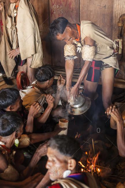 - December 5, 2012: Khiamniungan tribesman pouring tea, Nagaland, N.E. India