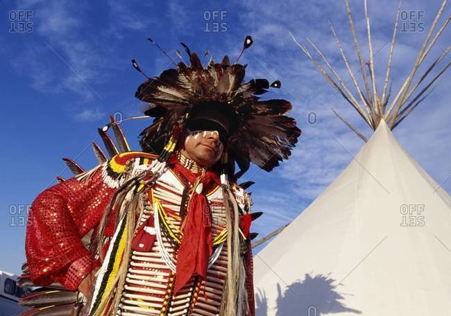 Low angle view of Native American man in traditional tribal clothing
