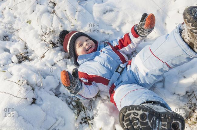 Little boy having fun in snow