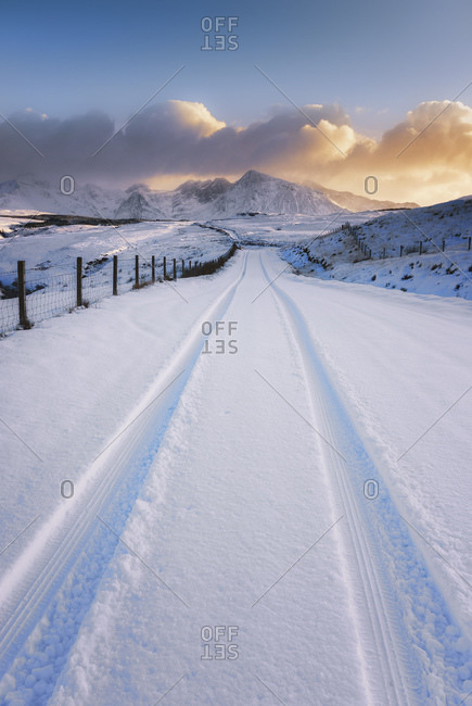 Street in the winter with tire tracks