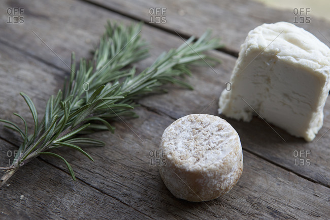 Close up of cheese with a rosemary twig