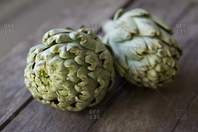 Close up of two artichokes