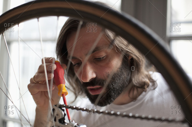 Close up of man repairing bicycle