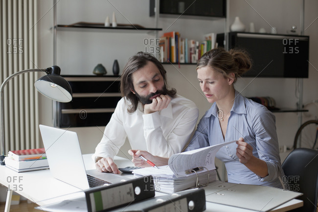 Man and woman review paperwork