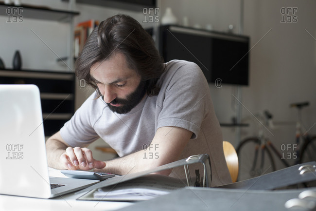 Man calculating household expensive