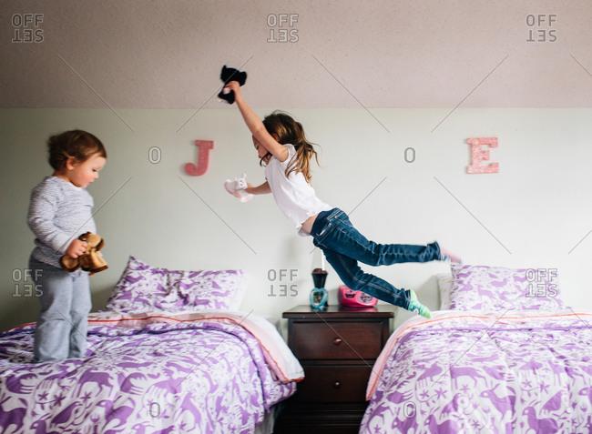 Girl jumps across beds