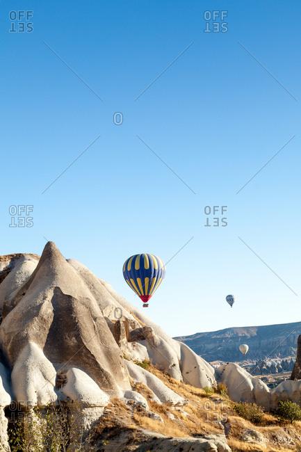 Cappadocia, Turkey - September 2013: Landscape in Zemi valley with hot air balloons
