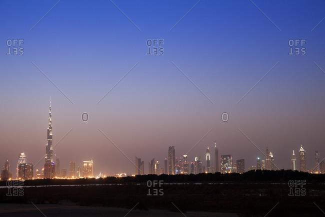 Dubai skyline at dusk, second building on the left is Burj Khalifa, tallest building in the world