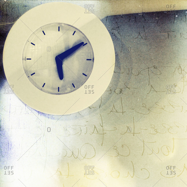 Clock of wall with writing