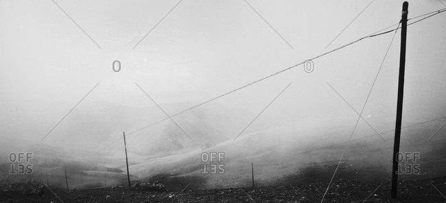 Barely visible town at foot of mountain