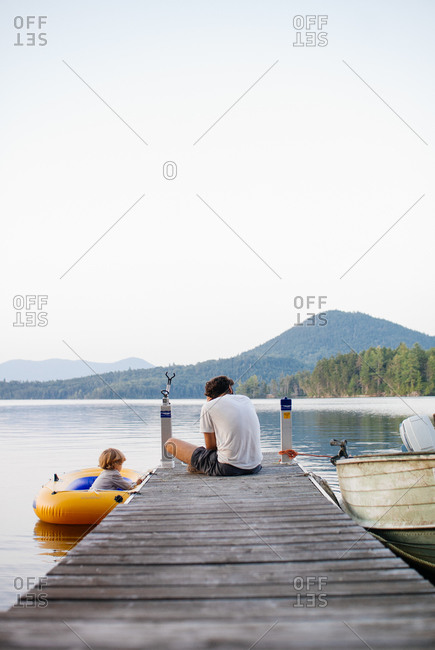 Son escaping in raft while father is distracted