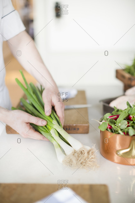 Man holding spring onion