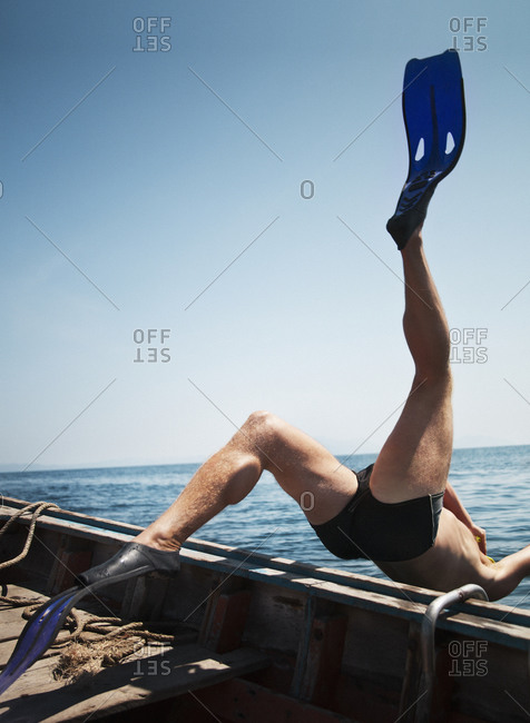 Diver plunging into the sea from a boat