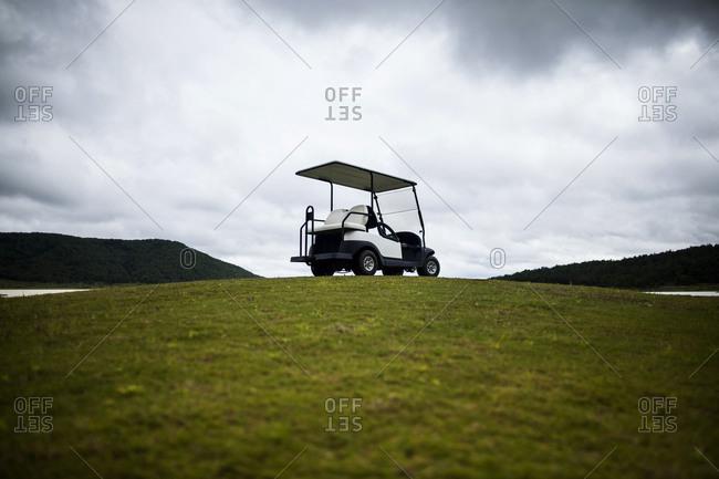 A solitary golf cart on a hill at a gold course, Dalat, Vietnam