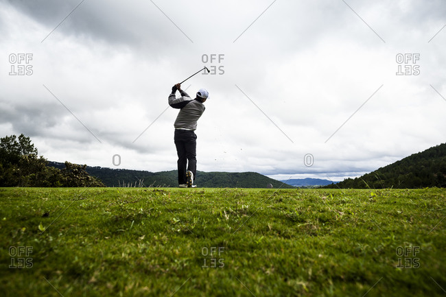 A golfer tees off at a mountainous course in Dalat, Vietnam.