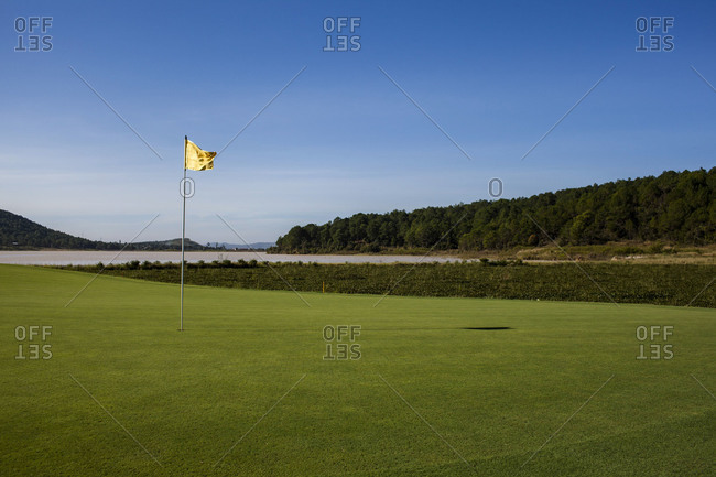 A flag on a mountainous golf course in Dalat, Vietnam.