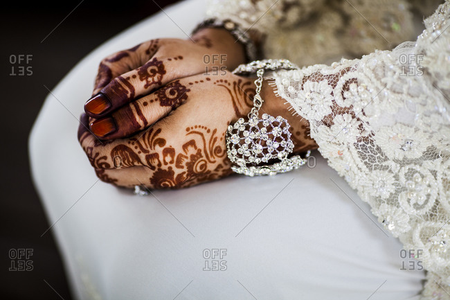 A young Malaysian bride with Henna on her hands at her wedding in Singapore.