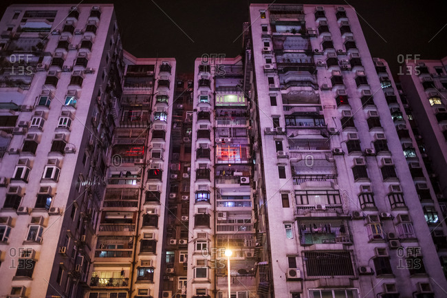 An apartment block at night in Macau, China