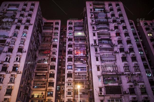 An apartment block at night in Macau, China