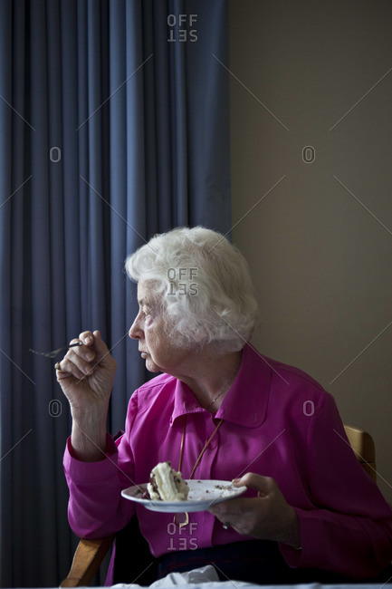 September 21, 2011, Germany-A woman eats cake in at a community center