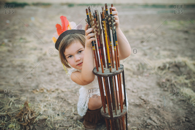Little girl posing by arrows