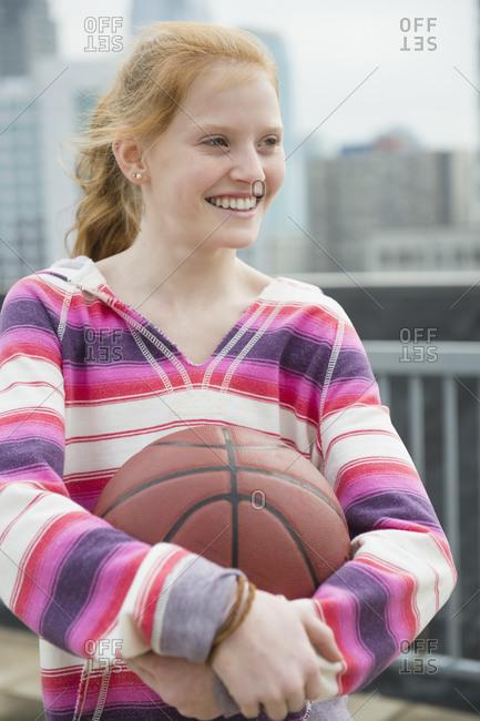 Portrait of girl holding ball