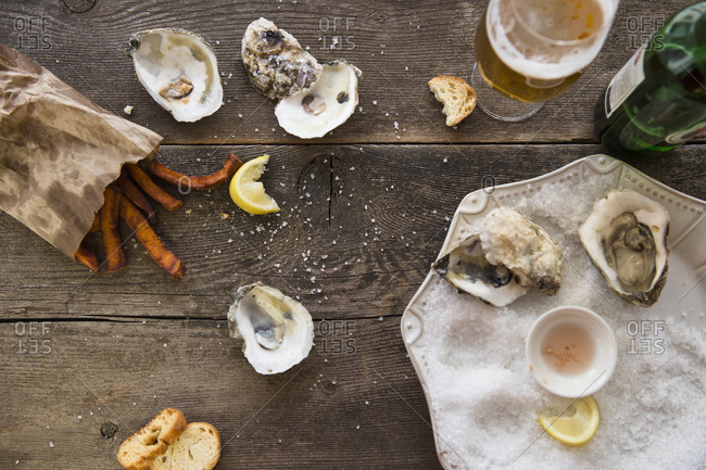 Glass of beer, oysters and french fries