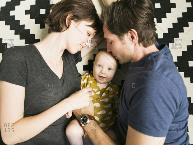 Portrait of parents with baby son