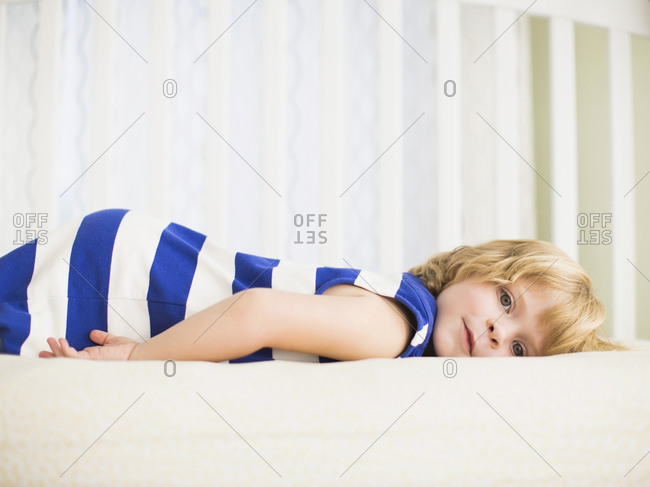 Girl resting on bed