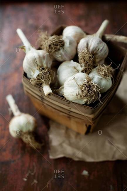 Close up of garlic bulbs in a basket