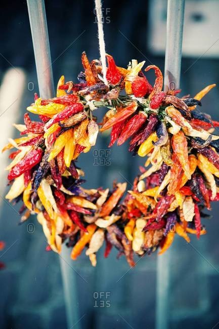Close up of a wreath made out of dry chili peppers