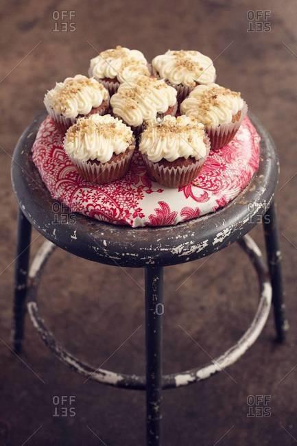 Hummingbird cupcakes on a stool