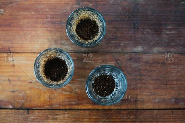 Three glasses with different kinds of ground coffee