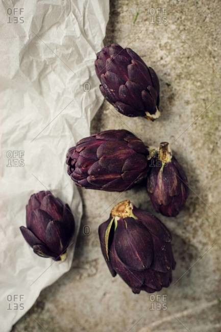 Top view of purple artichokes