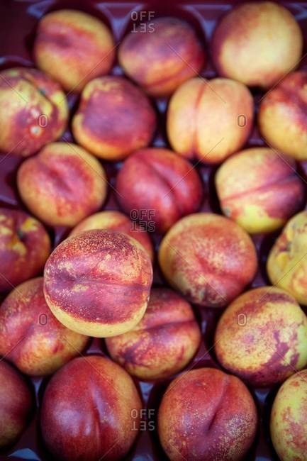 Peaches on display at a market