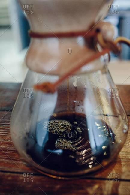 Dip brewing coffee into a carafe