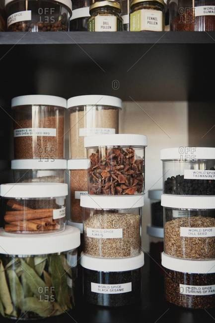 Various spices in container on a shelf