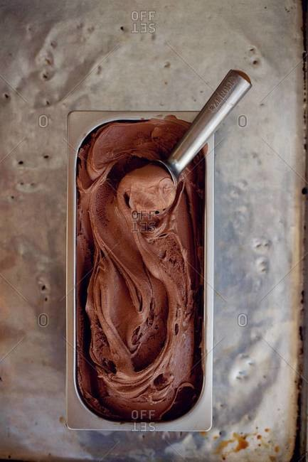 Dutch chocolate gelato with a scoop