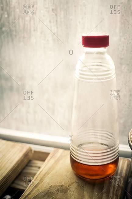 Plastic bottle with brown liquid
