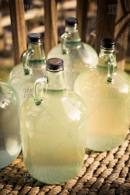 Jugs full of hazy liquid
