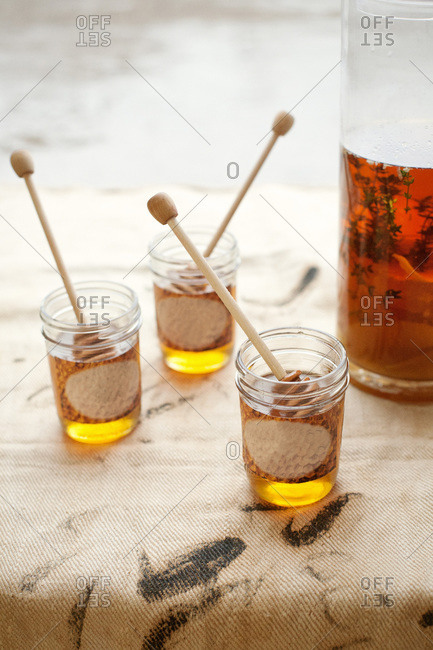 Three jars of honey with honey infused bourbon