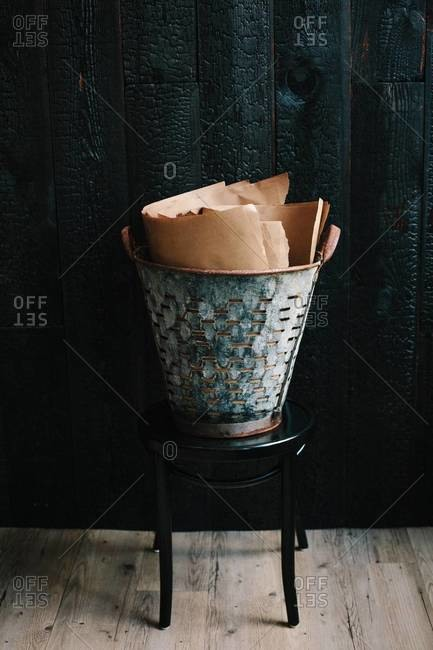 Sheets of brown papers in rusty basket