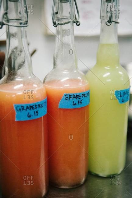 Grapefruit and lime juices in bottles