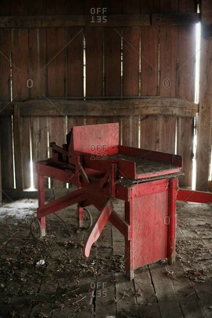 Red machinery in a barn